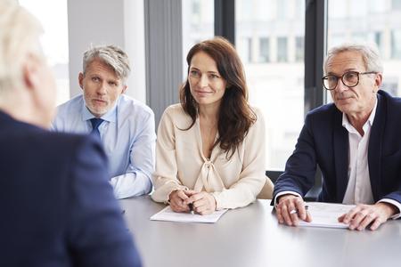 Photo pour Serious, business talks at conference table - image libre de droit