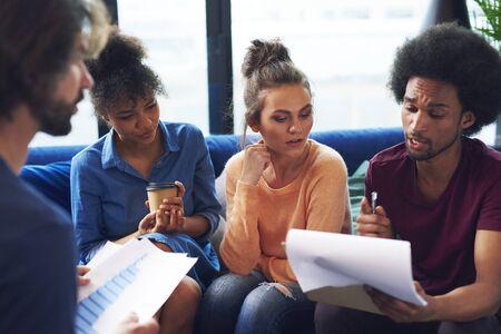Foto de Young coworkers analyzing the charts - Imagen libre de derechos