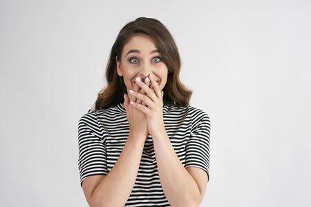 Foto de Portrait of surprised woman in studio shot - Imagen libre de derechos