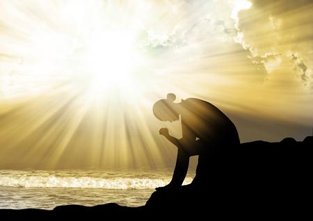 Photo pour Woman praying to god at sunset - image libre de droit