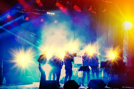 Photo for ensemble playing night concert on the stage - Royalty Free Image