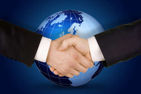 Business handshake. Image of businesspeople handshake on the world globe background,