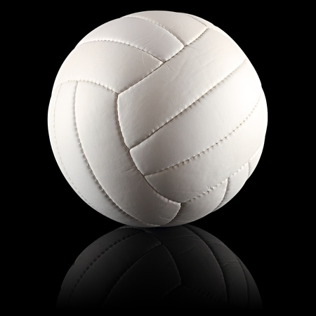 a white volleyball on black background