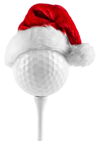 golf ball on tee with santa hat