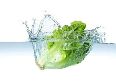 Photo pour head of lettuce splashes into the water - image libre de droit