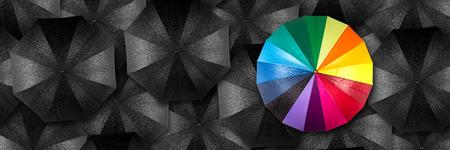 Photo pour rainbow umbrella in mass of black umbrellas - image libre de droit