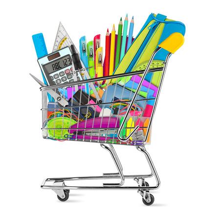Foto de school / office supplies in shopping cart isolated on white background - Imagen libre de derechos