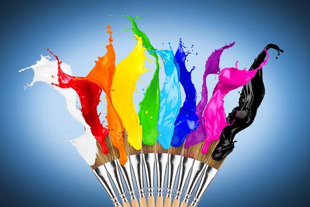Photo pour colorful color splashes paintbrush row isolated on blue background - image libre de droit