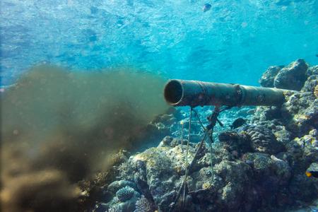 Foto de underwater sewer wastewater pipe in coral reef enviroment nature protection damage pollution sea ocean concept background - Imagen libre de derechos