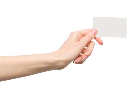 Photo for Female hand holding a blank business card - Royalty Free Image