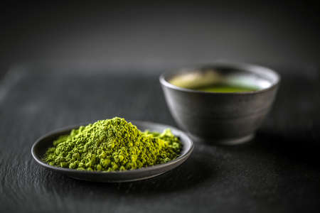 Photo for Matcha, powder green tea in black plate - Royalty Free Image