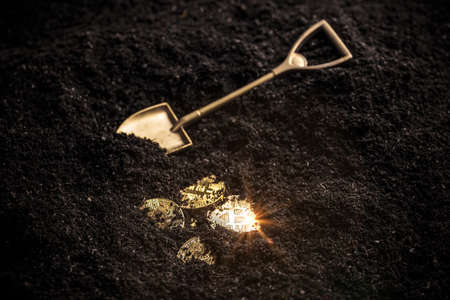 Photo for Golden bitcoin mining from the soil with shovel - Royalty Free Image
