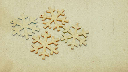 Photo pour Wooden stars in retro style covered with sepia-colored texture. Image showing the festive atmosphere in the form of a Christmas card. - image libre de droit
