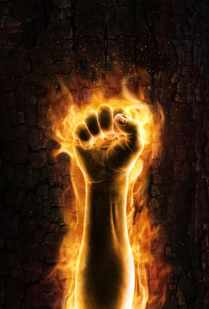 Foto de Fist of fire  Grungy burning fist of fire - Imagen libre de derechos