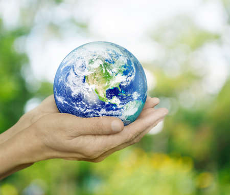 Photo pour Earth in hands on green bokeh background, Environment concept - image libre de droit