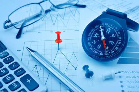 Foto de Blue compass, pen and pin on graph paper, success concept - Imagen libre de derechos