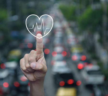 Foto de Heart beat pulse flat icon over blur of rush hour with cars and road in city, Business medical health care service concept - Imagen libre de derechos