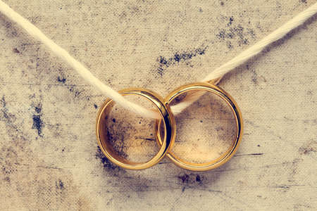 Photo for Wedding rings hanging on rope. Vintage image. - Royalty Free Image