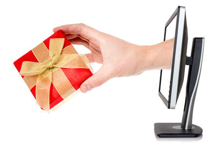 Foto de Hand with gift box comes out of monitor.Isolated on white background. - Imagen libre de derechos