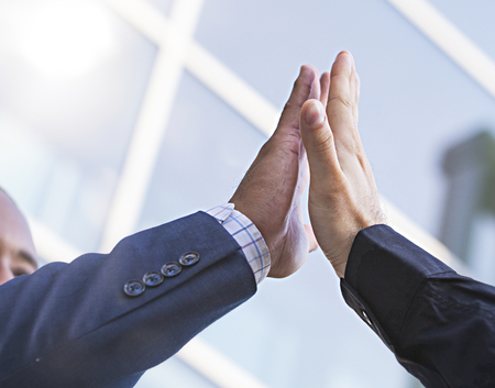 Photo for Close-up of two businessmen giving fist bump. Partnership concept - Royalty Free Image