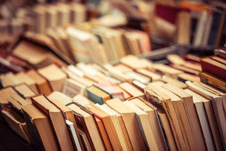 Foto de Many old books in a book shop or library - Imagen libre de derechos