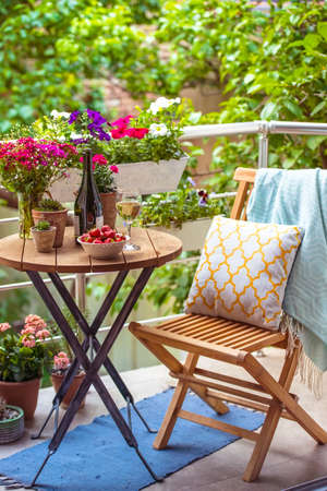 Photo for Beautiful terrace or balcony with small table, chair and flowers - Royalty Free Image