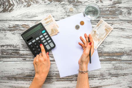 Photo for Woman counting euro money with calculator. Business concept. Top view - Royalty Free Image