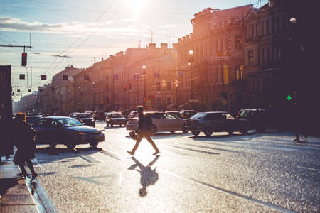 Foto de People crossing Nevsky prospect. Sunny evening in Saint Petersburg, Russia. Toned picture - Imagen libre de derechos