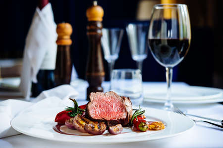 Photo for Beef steak with grilled vegetables served on white plate - Royalty Free Image