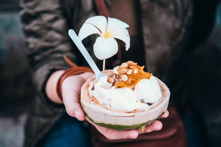 Photo for Coconut ice cream with nuts in Thailand - Royalty Free Image