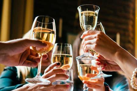Foto de Glasses of white wine seen during a friendly party of a celebration. - Imagen libre de derechos