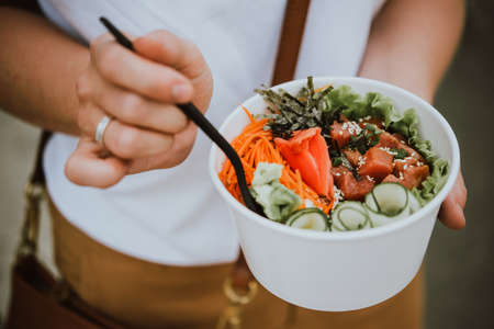 Photo for Poke bowl - raw fish salad served as an appetizer, Hawaiian cuisine - Royalty Free Image