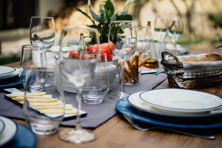 Photo pour Table served for party dinner in mediterranean style - image libre de droit