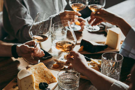 Photo pour Wine and cheese served for a friendly party in a bar or a restaurant. - image libre de droit