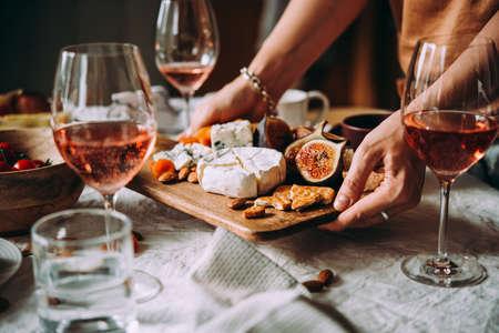 Photo pour Offering appetizers at a friendly party. Dinner or aperitivo party concept. - image libre de droit