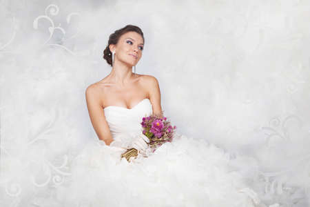 Photo for Brunet bride portrait with flowers in studio - Royalty Free Image