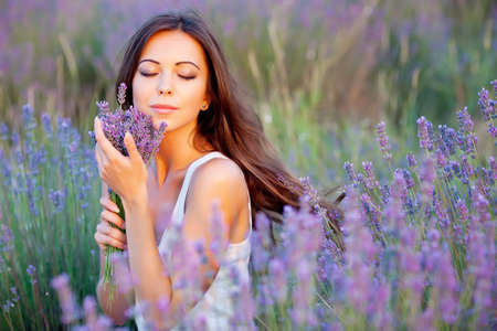 Photo for smiling beautuful brunette in the lavender field - Royalty Free Image