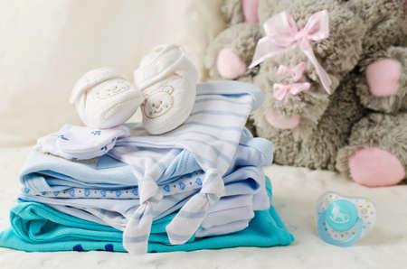 Foto de Baby clothes for newborn. In pastel colors - Imagen libre de derechos