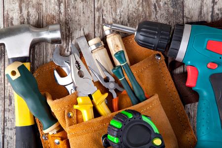 Foto de set of tools in tool box on a wooden background - Imagen libre de derechos
