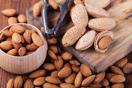 Photo for almonds nuts on a wooden table - Royalty Free Image