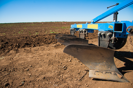 Photo pour Tractor plowing fields - preparing land for sowing - image libre de droit