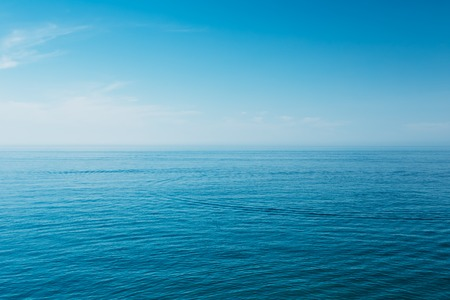 Foto de Calm Sea Ocean And Blue Sky Background - Imagen libre de derechos