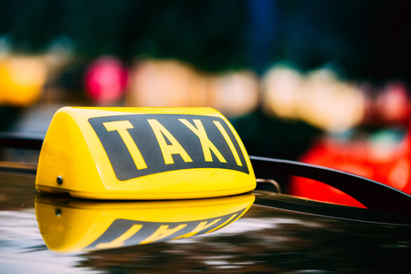 Photo for Taxi Sign On Roof Of Car - Royalty Free Image