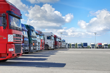 Photo pour St. Petersburg, Russia - July 27, 2017: A fleet of trucks with a trailer, parking in the territory of a logistics terminal. - image libre de droit