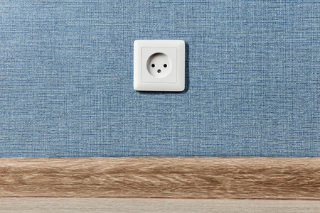 Foto de Euro electric outlet type C, electrical point of power in house, on the blue wall background. - Imagen libre de derechos