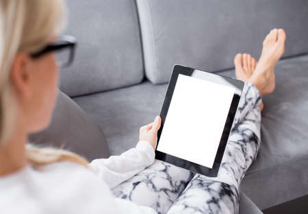 Foto de Woman reading ebook on tablet computer - Imagen libre de derechos