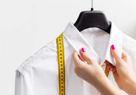 Photo for Woman tailoring business shirt - Royalty Free Image