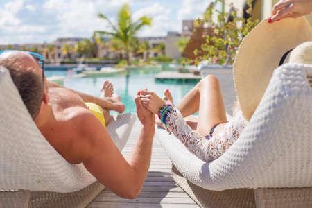 Photo for Couple enjoying vacation in luxury resort - Royalty Free Image