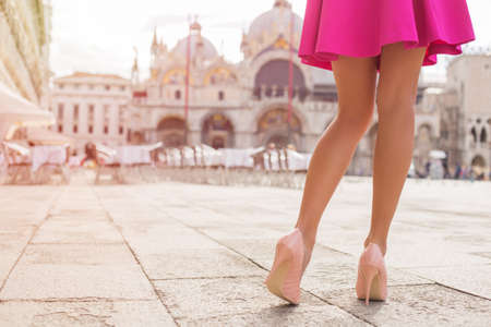 Photo for Sexy tourist walking on St Marks Square in Venice - Royalty Free Image