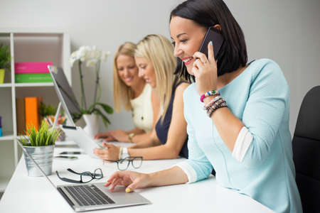 Photo for Creative women colleagues working in the office - Royalty Free Image